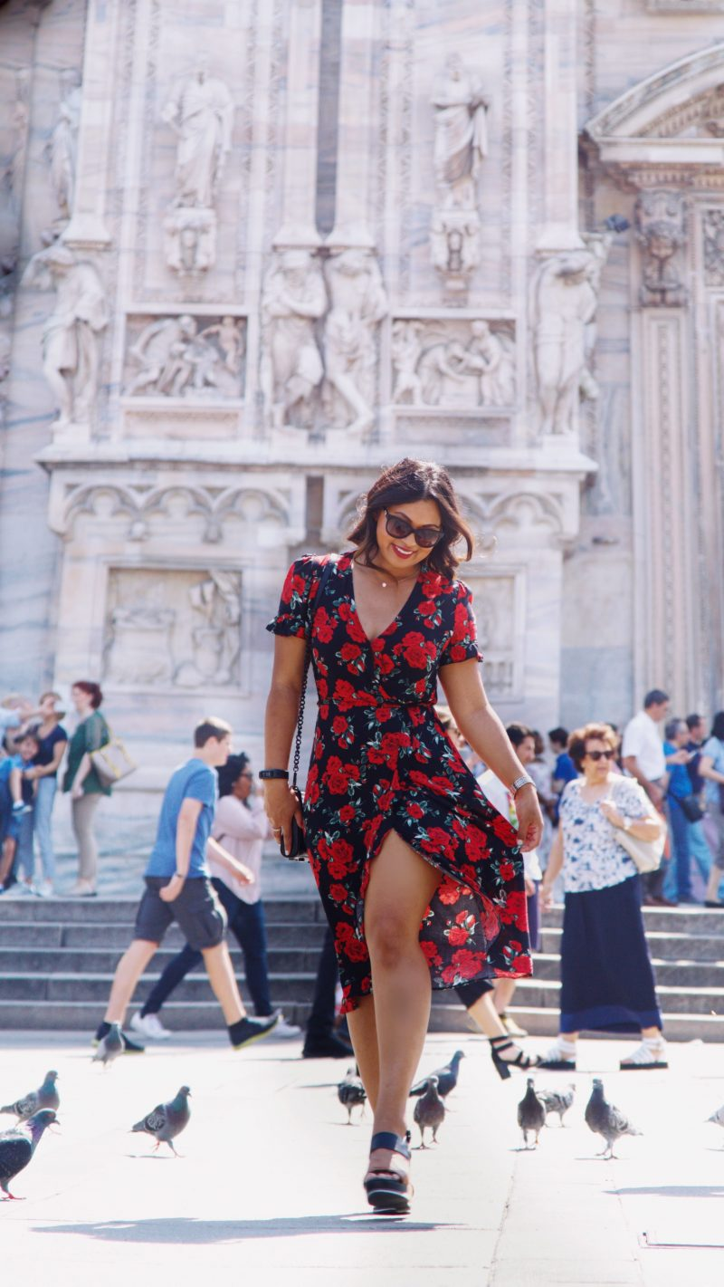 A healthy relationship with yourself. Fashion blogger outside of Duomo di Milano wearing a rose printed summer dress from Primark, black and brown wedges from Vince Camuto and a Rebecca Minkoff handbag.